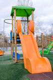 Kids playground. A colorful kids playground with various slides in a park Stock Images