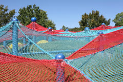 Kids playground. Blue and red spider net construction on kids playground Royalty Free Stock Images