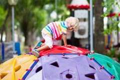 Child on school playground. Kids play. Royalty Free Stock Images