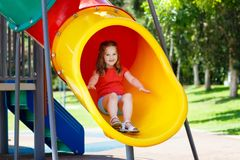 Kids on playground. Children play in summer park. Kids climbing and sliding on outdoor playground. Children play in sunny summer park. Activity and amusement Royalty Free Stock Photo