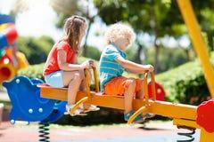 Kids on playground. Children play in summer park. Stock Photo