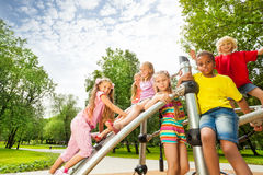 Kids on playground construction play, girl climb Royalty Free Stock Photos