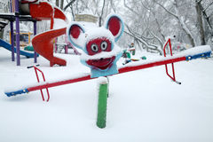Kids playground covered with snow Stock Images
