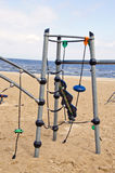 Kids playground on empty sea beach in morning Royalty Free Stock Photos