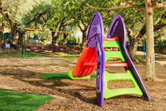 Kids playground in a garden Royalty Free Stock Image