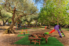 Kids playground in a garden Royalty Free Stock Photography