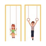 Kids at playground, hanging on gymnastic rings. swinging on swings Stock Image