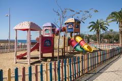Kids playground at Kleopatra Beach Alanya Turkey. Kids Playground at Cleopatra Beach in Alanya Turkey shot on sunny day with sea blue sky and palm trees on Royalty Free Stock Photo