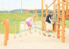 Kids on playground Stock Image