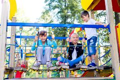 Kids on playground. A portrait of several kids on a playground royalty free stock photo