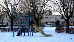 Kids Playground With Slide Covered in Snow During Winter stock photography