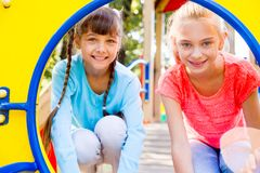 Kids on playground. Kids are spending time on a playground stock photo