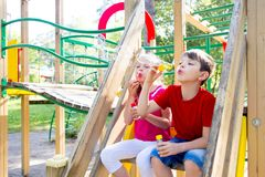 Kids on playground. Kids are spending time on a playground royalty free stock images