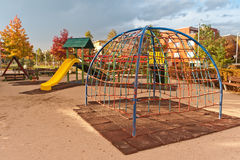 Kids playground in urban autumn park royalty free stock photography