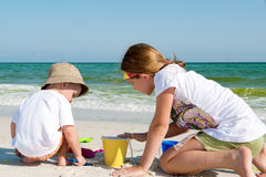 Kids playin by the ocean Stock Image