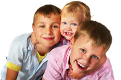 Kids playing. Two brothers and sister playing; closeup faces Stock Photos