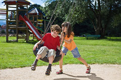 Kids playing. Kids having fun in park Stock Images