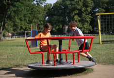Kids playing. Kids having fun in park Royalty Free Stock Photography