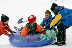 Kids Playing. In a Snow Storm Royalty Free Stock Photos
