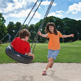 Kids playing. Kids having fun in park Royalty Free Stock Images
