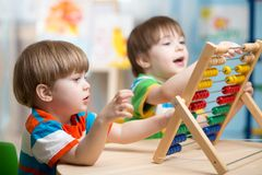 Kids playing with abacus Royalty Free Stock Photo