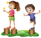Kids playing above the stumps Royalty Free Stock Photos