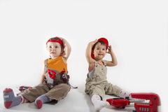 Kids  Playing as Construction Workers on white Stock Photos