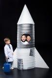 Kids playing astronauts stock photo