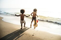 Free Kids Playing At The Beach Royalty Free Stock Photo - 118321015