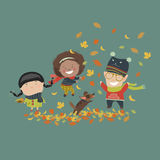 Kids playing with autumn leaves Stock Images