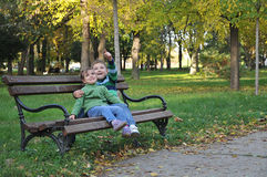 Kids playing in autumn park Stock Images