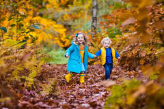 Kids playing in autumn park Royalty Free Stock Photos