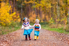 Kids playing in autumn park Royalty Free Stock Photo