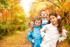 Kids playing in an autumn park royalty free stock images