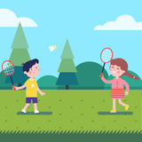 Kids playing badminton outdoor on the grass Stock Photo