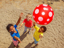 Kids playing with a ball. Group of school aged kids playing with a ball outside royalty free stock photo