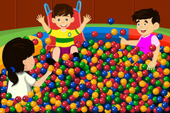 Kids playing in ball pool stock illustration