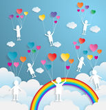 Kids playing with balloon heart shape,paper art style Stock Photography