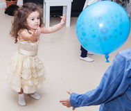 Kids playing balloon at home Royalty Free Stock Image