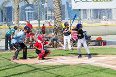 Kids playing baseball on Dubai fields,November 2015, UAE. Royalty Free Stock Photo