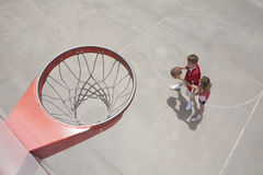 Kids playing basketball Royalty Free Stock Images