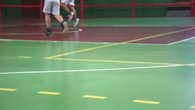 Kids playing basketball foot closeup shoot stock video footage