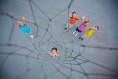 Kids playing basketball Royalty Free Stock Photo