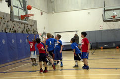 Kids playing basketball match. Second graders were having a basketball match on Saturday at Gateway high school near Seattle, USA Royalty Free Stock Image