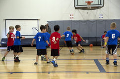 Kids playing basketball match Stock Image