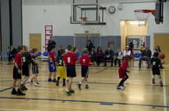 Kids playing basketball match Stock Photo