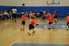 Kids playing basketball match. Young kids playing basketball match in an indoor court in San Antonio, Texas Royalty Free Stock Photos