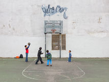 Kids playing basketball Stock Images
