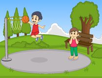Kids playing basketball in the park Royalty Free Stock Image