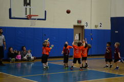 Kids playing basketball. Young kids playing basketball match in an indoor court in San Antonio, Texas Stock Images